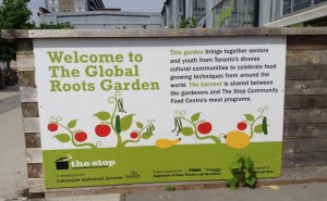 The Stop Roots Garden sign.