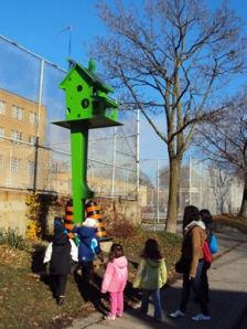 Kids looking at birdhouse