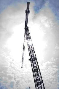 Crane in clouds.