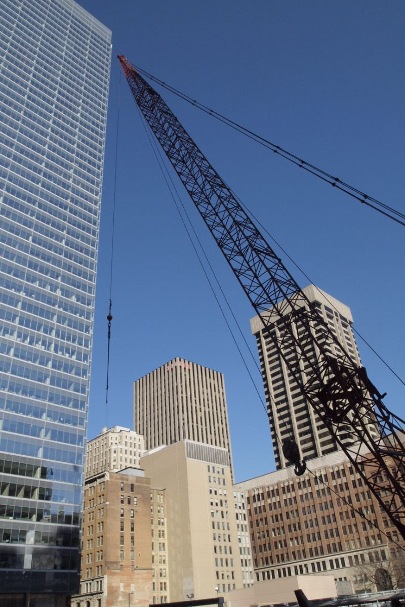 Crane downtown surrounded by office towers.