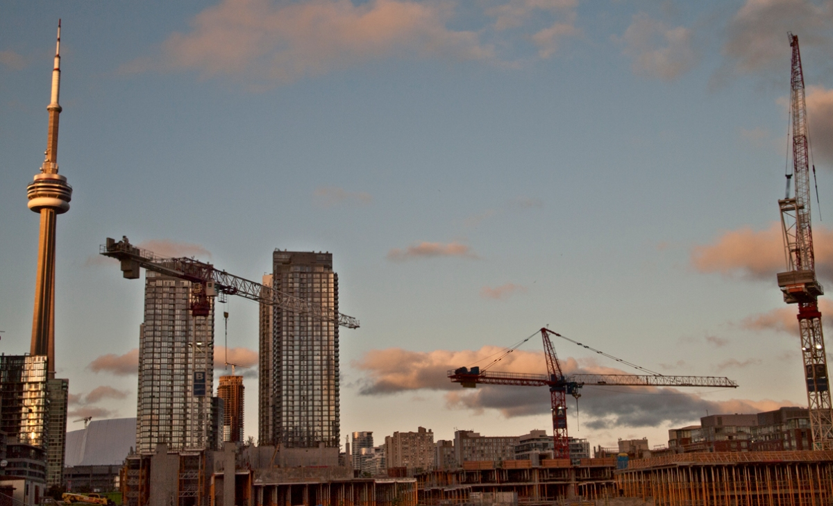 CN tower and cranes at sunset.