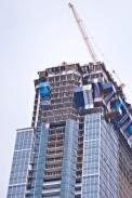 Crane atop building.