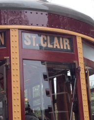 Old streetcar with St. Clair sign in window.