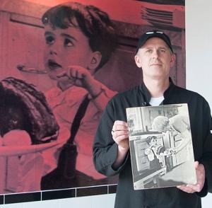 Roast butcher holds photo.