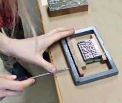 Type being set for letterpress.