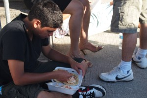 Boy eating on the street