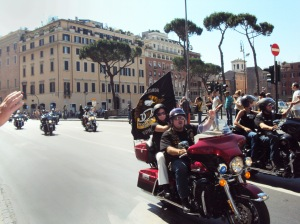 harley riders with flag in Rome