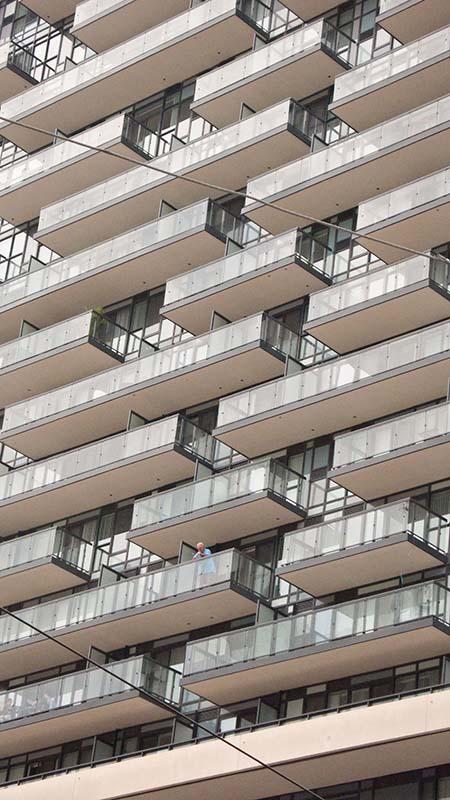 Man on balcony.
