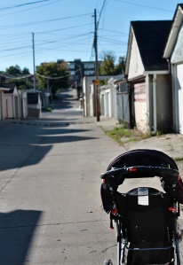 Baby stroller in back lane.