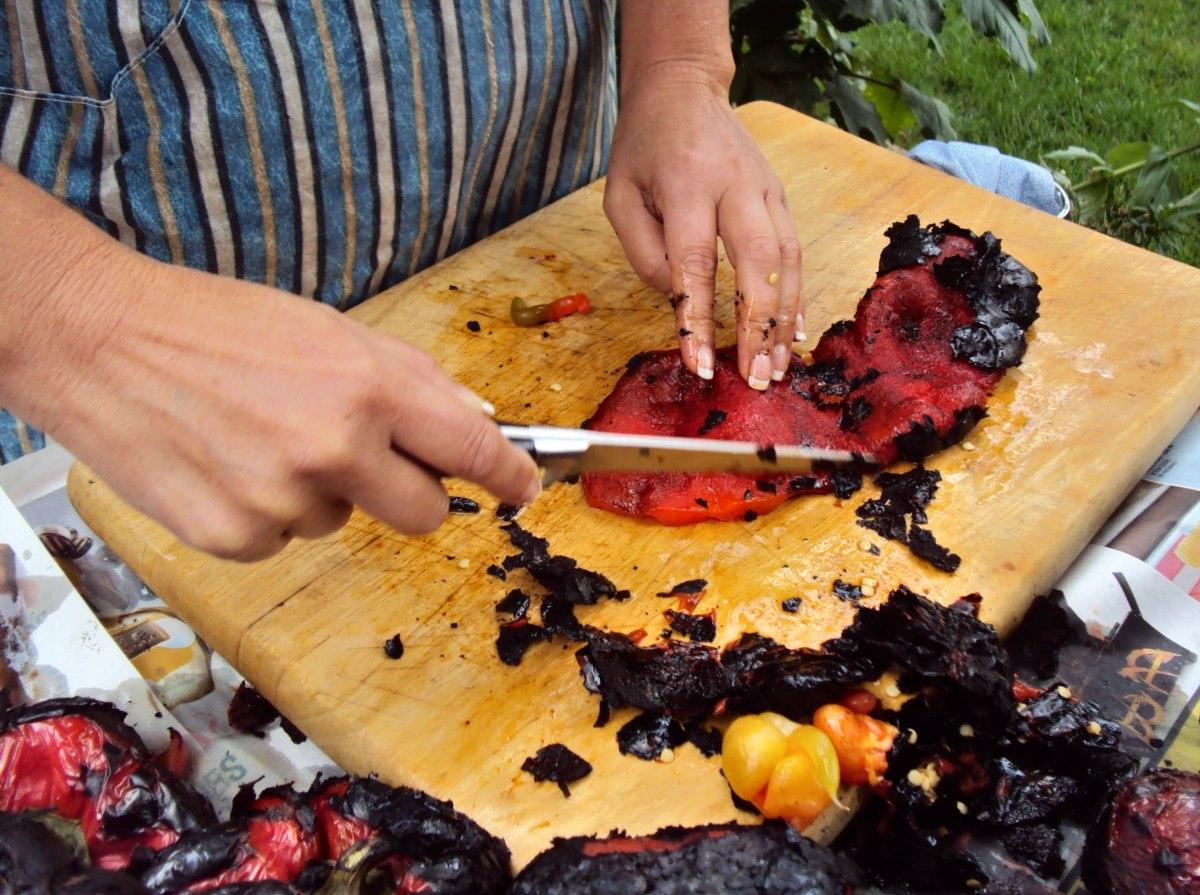 Peeling roasted red peppers.
