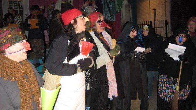 Group of befanas singing.