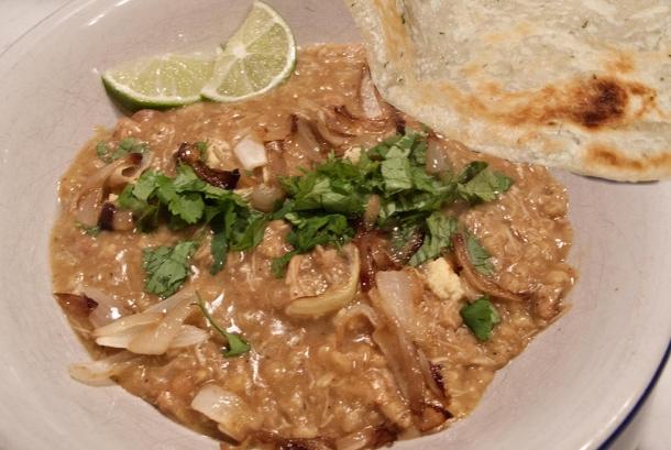 Dish of haleem with paratha.