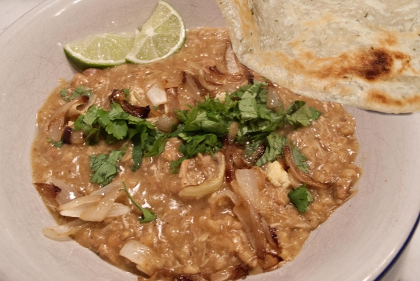 Dish of haleem with paratha.