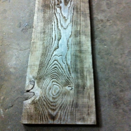 Plank grain enhanced by burning, for reno of Boxcar Social.