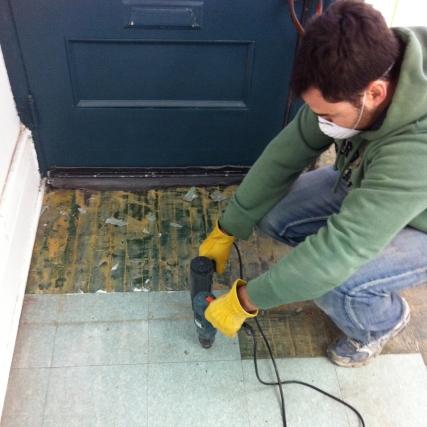 Ripping up old floor tiles at Boxcar Social.