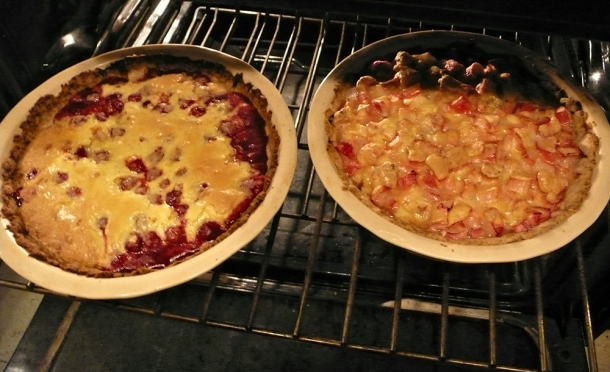 Two baked pies in oven.
