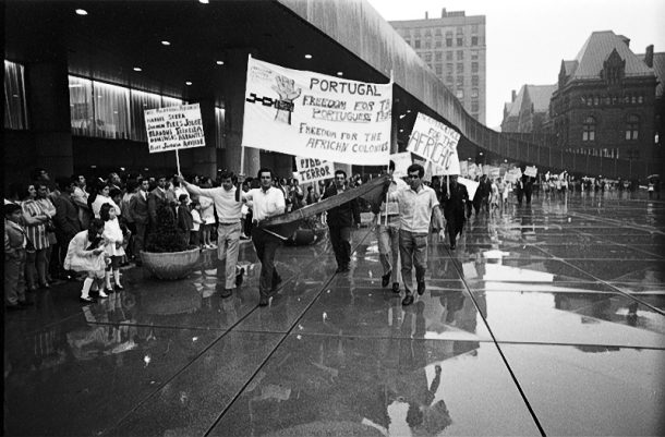 Anti-fascist and anti-colonial protest by PCDA members on Nathan Pillips Square, during Toronto's Portugal Day celebration on June 14, 1971. Photo by Russell, York University Libraries, Clara Thomas Archives & Special Collections, Toronto Telegram fonds, F0433, ASC08245.