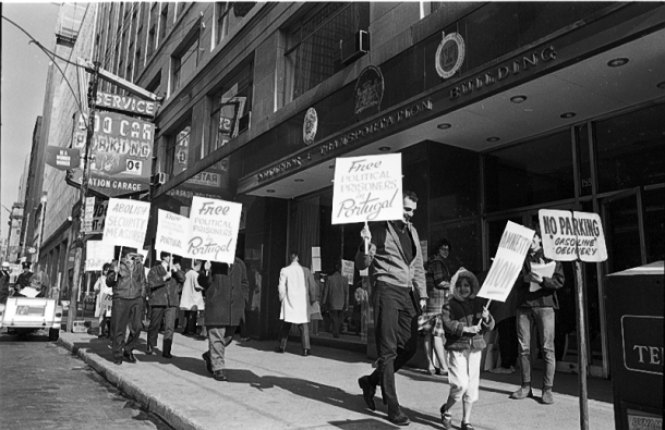 Portuguese exiles demanding the release of political prisoners in Salazar's Portugal, picketing outside the Portuguese consulate on Bay St., October 1966. Photo by Reed, York University Libraries, Clara Thomas Archives & Special Collections, Toronto Telegram fonds, F0433, ASC08256.