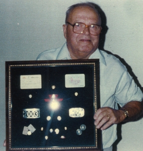 John Wood with framed TTC badges.