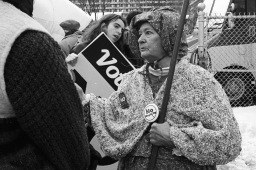 Two women demonstrating against the megacity.