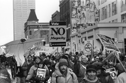 March near Wellesley on Yonge St. against the megacity.