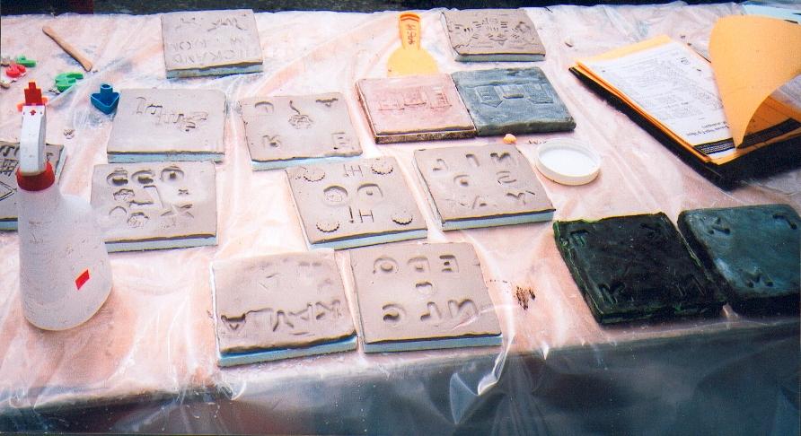 Tiles made at workshop for the Community Totem.