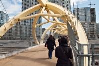 Walkers crossing Puente de Luz.