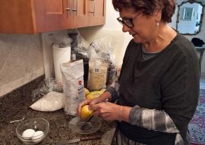 Zesting lemon.