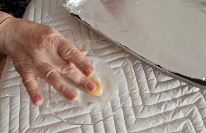 Pressing cookie in sugar.