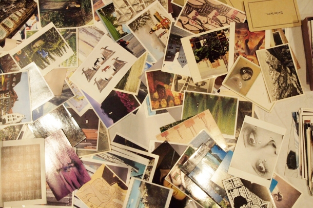 Table piled with postcards