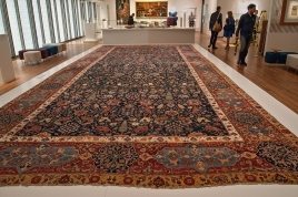 Large carpet in gallery.