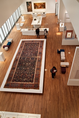 Large carpet in gallery from above.