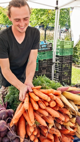 Paul arranging carrots.