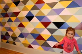 Feature wall with little girl.