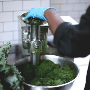 Juicing greens.