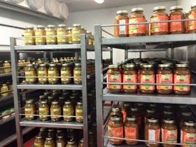 Shelves of soup in jars.