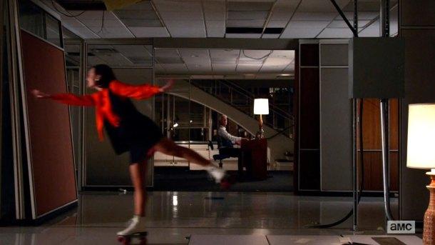 Peggy Olsen rollerskating.