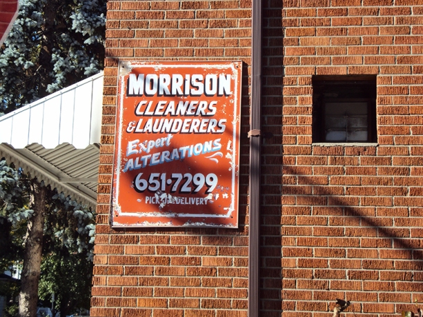 Morrison Cleaners sign on building.