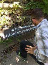 Painting Bilton Laneway sign.