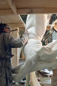 Moyle sanding plaster figure.