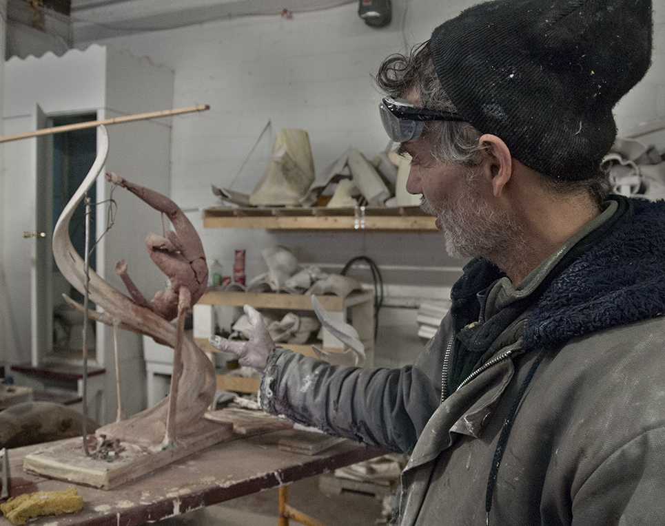Sculptor with maquette.
