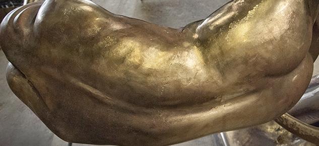 Bronze torso.