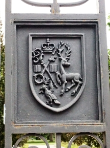 Crest on Trinity Bellwoods fence.