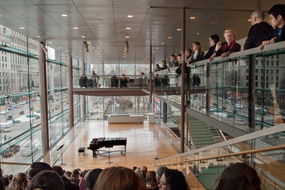 Audience standing at upper level.