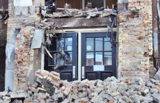 Hughes P.S. front doors during destruction.