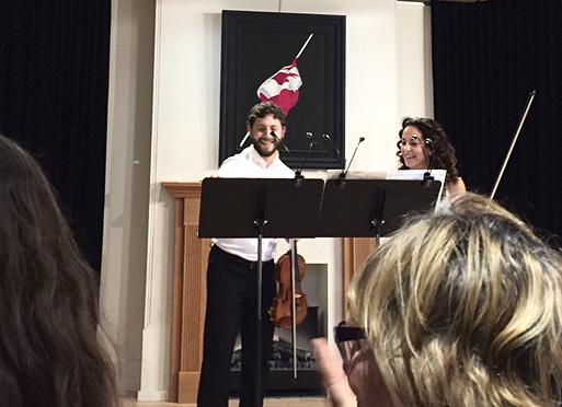 Violin duo.