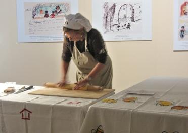 Marietta rolling pasta.