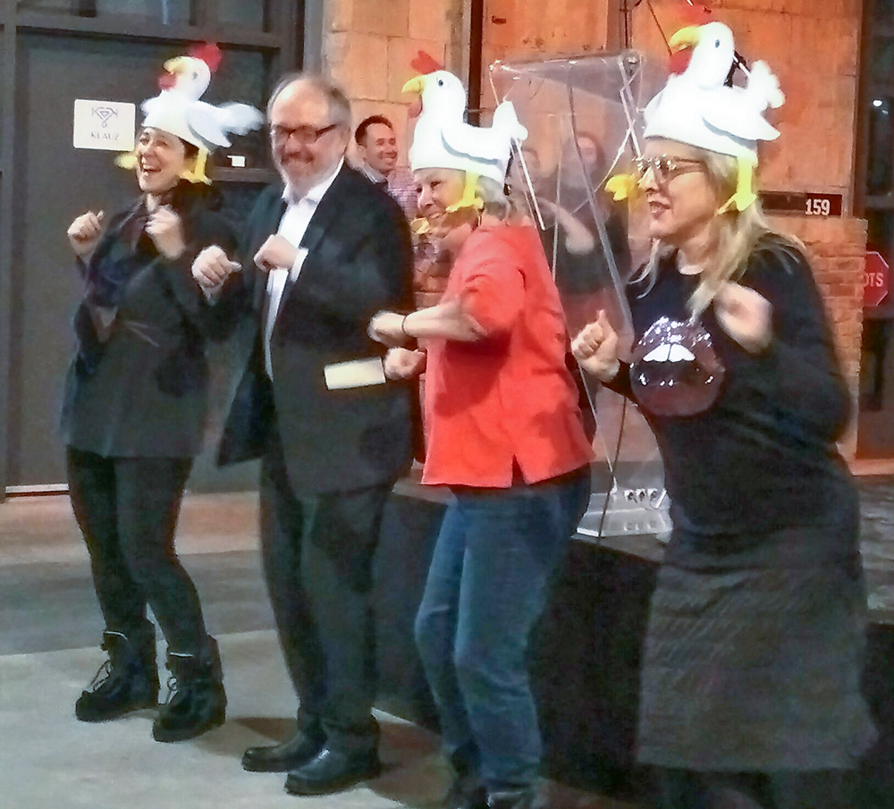 Chicken dance by Joe Mihevc and three women.