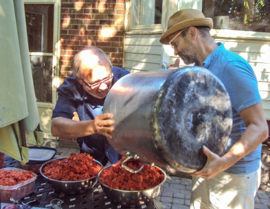 Joe and Mike Layton dumping out tomato skins.