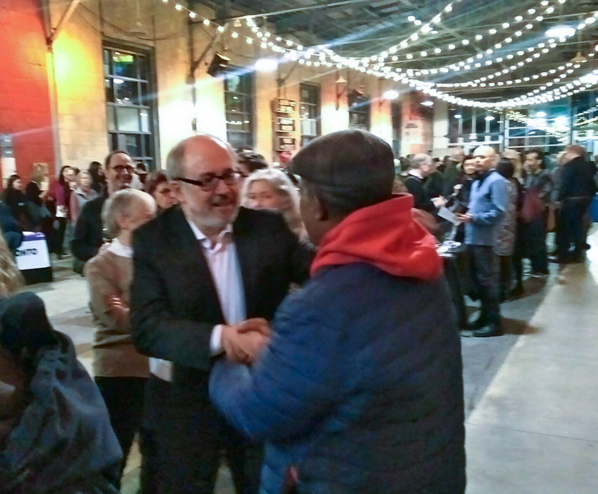 Joe Mihevc greeting supporters at party.